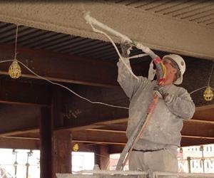 Man spraying fireproofing material